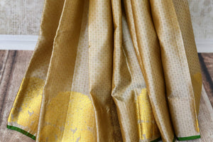Buy traditional beige Kanjivaram silk saree online in USA with zari buta and maroon pallu. Make your Indian saree look rich with beautiful Indian Kanchipuram sarees from Pure Elegance Indian clothing in USA or shop online.-pleats
