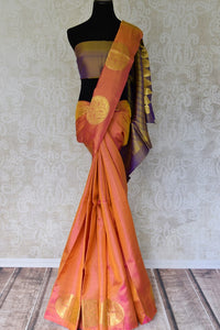 Buy beautiful orange color Kanjeevaram silk saree online in USA with zari buta and purple pallu. Make your Indian saree look rich with beautiful Indian Kanchipuram sarees from Pure Elegance Indian clothing in USA or shop online.-full view
