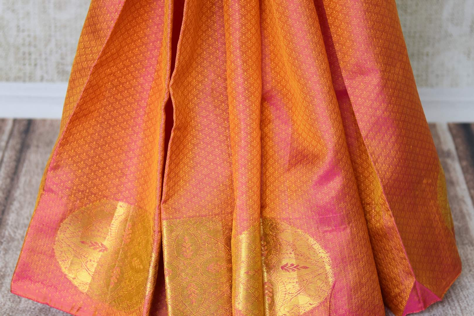 Buy beautiful orange color Kanjeevaram silk saree online in USA with zari buta and purple pallu. Make your Indian saree look rich with beautiful Indian Kanchipuram sarees from Pure Elegance Indian clothing in USA or shop online.-pleats
