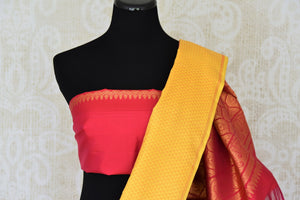 Buy online yellow and blue Kanchipuram silk saree in USA with pink zari pallu and zari buta.  For all the Indian women in USA who love Indian clothing and sarees, Pure Elegance clothing store in USA brings an exquisite collection of designer silk sarees, Kanjivaram sarees online and in their store. Shop now.-blouse pallu