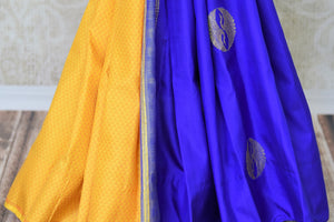 Buy online yellow and blue Kanchipuram silk saree in USA with pink zari pallu and zari buta.  For all the Indian women in USA who love Indian clothing and sarees, Pure Elegance clothing store in USA brings an exquisite collection of designer silk sarees, Kanjivaram sarees online and in their store. Shop now.-pleats