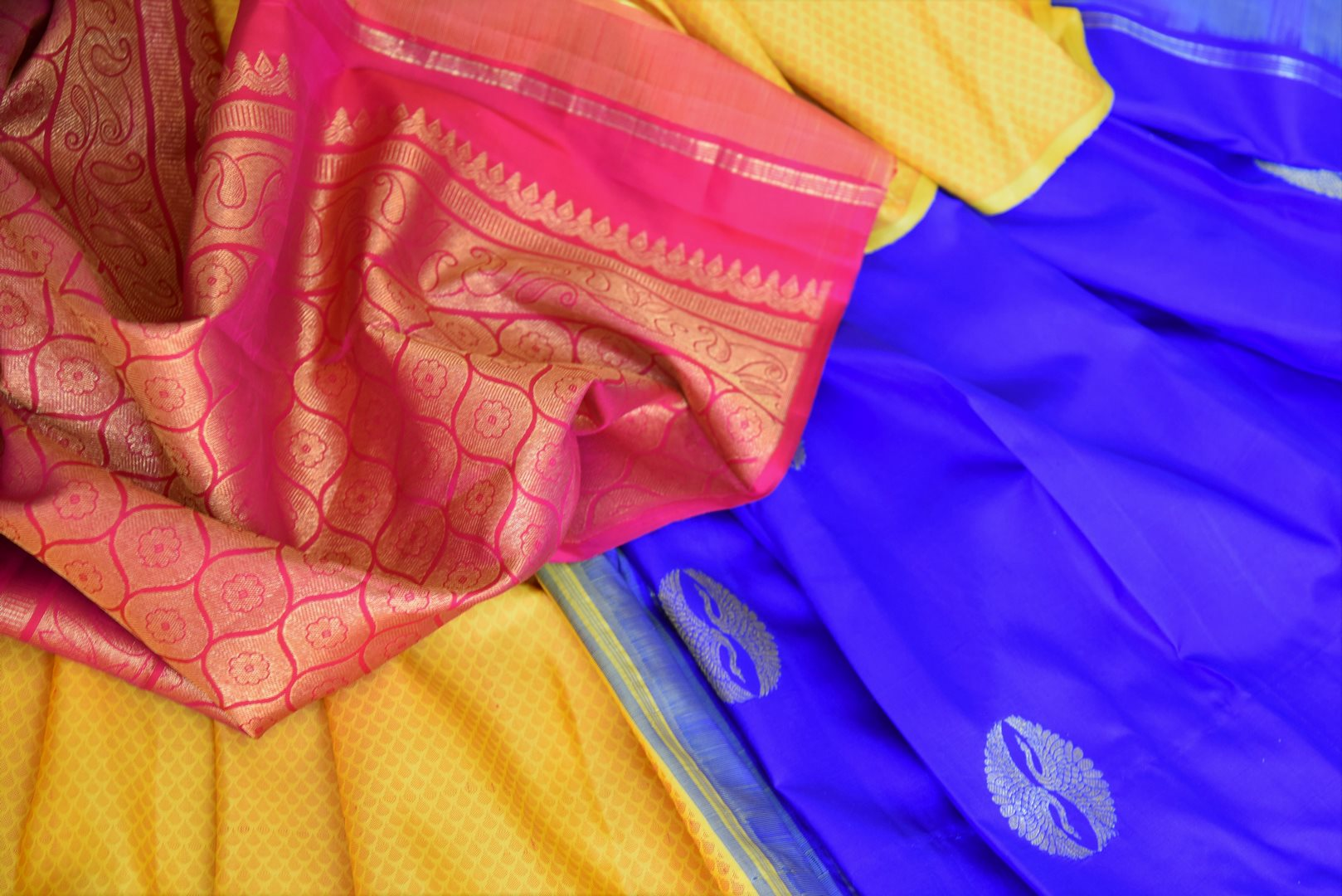 Buy online yellow and blue Kanchipuram silk saree in USA with pink zari pallu and zari buta.  For all the Indian women in USA who love Indian clothing and sarees, Pure Elegance clothing store in USA brings an exquisite collection of designer silk sarees, Kanjivaram sarees online and in their store. Shop now.-details