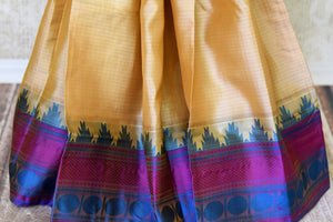 Buy cream color Kanjeevaram silk saree online in USA with blue temple border. Make your Indian saree look rich with beautiful Indian Kanchipuram saris from Pure Elegance Indian clothing in USA or shop online.-pleats