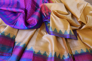 Buy cream color Kanjeevaram silk saree online in USA with blue temple border. Make your Indian saree look rich with beautiful Indian Kanchipuram saris from Pure Elegance Indian clothing in USA or shop online.-details