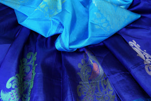 Shop dark blue Kanjeevaram silk saree with zari buta online in USA. Adorn your style with a range of exquisite Kanchipuram sarees from Pure Elegance Indian clothing store in USA. We have an exquisite range of Indian designer sarees, silk saris, Banarasi saris and many other varieties also available at our online store.-details