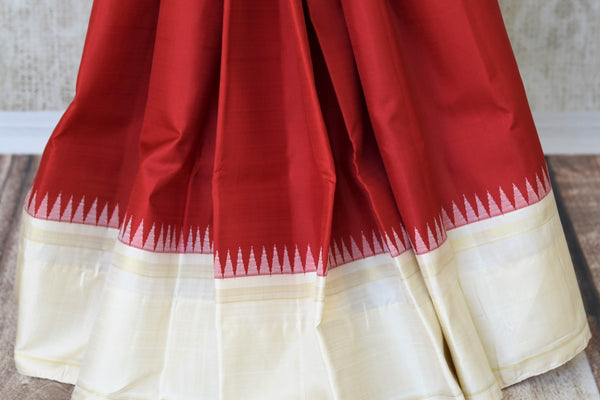Buy online red Kanchipuram silk sari in USA with cream border and pallu.  For all the Indian women in USA who love Indian clothing and sarees, Pure Elegance clothing store in USA brings an exquisite collection of designer silk sarees, Kanjivaram silk sarees online and in store. Shop now.-pleats