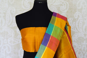 Buy online black Kanchipuram silk saree in USA with multicolor check border.  For all the Indian women in USA who love Indian clothing and sarees, Pure Elegance clothing store in USA brings an exquisite collection of designer silk sarees, Kanjivaram silk saris online and in store. Shop now.-blouse pallu