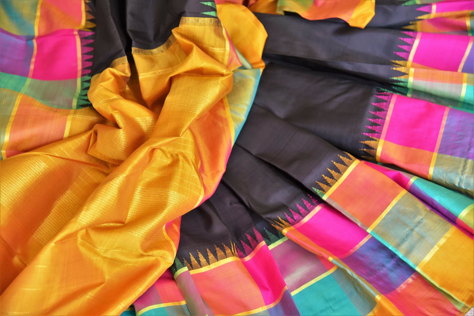 Buy online black Kanchipuram silk saree in USA with multicolor check border.  For all the Indian women in USA who love Indian clothing and sarees, Pure Elegance clothing store in USA brings an exquisite collection of designer silk sarees, Kanjivaram silk saris online and in store. Shop now.-details