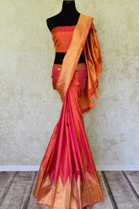Shop orange pink Kanjeevaram silk saree with temple zari border online in USA. Adorn your style with a range of exquisite Kanchipuram saris from Pure Elegance Indian clothing store in USA. We have an exquisite range of Indian designer sarees, silk saris, Banarasi saris and many other varieties also available at our online store.-full view