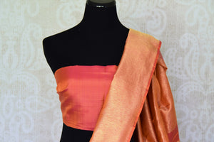 Shop orange pink Kanjeevaram silk saree with temple zari border online in USA. Adorn your style with a range of exquisite Kanchipuram saris from Pure Elegance Indian clothing store in USA. We have an exquisite range of Indian designer sarees, silk saris, Banarasi saris and many other varieties also available at our online store.-blouse pallu