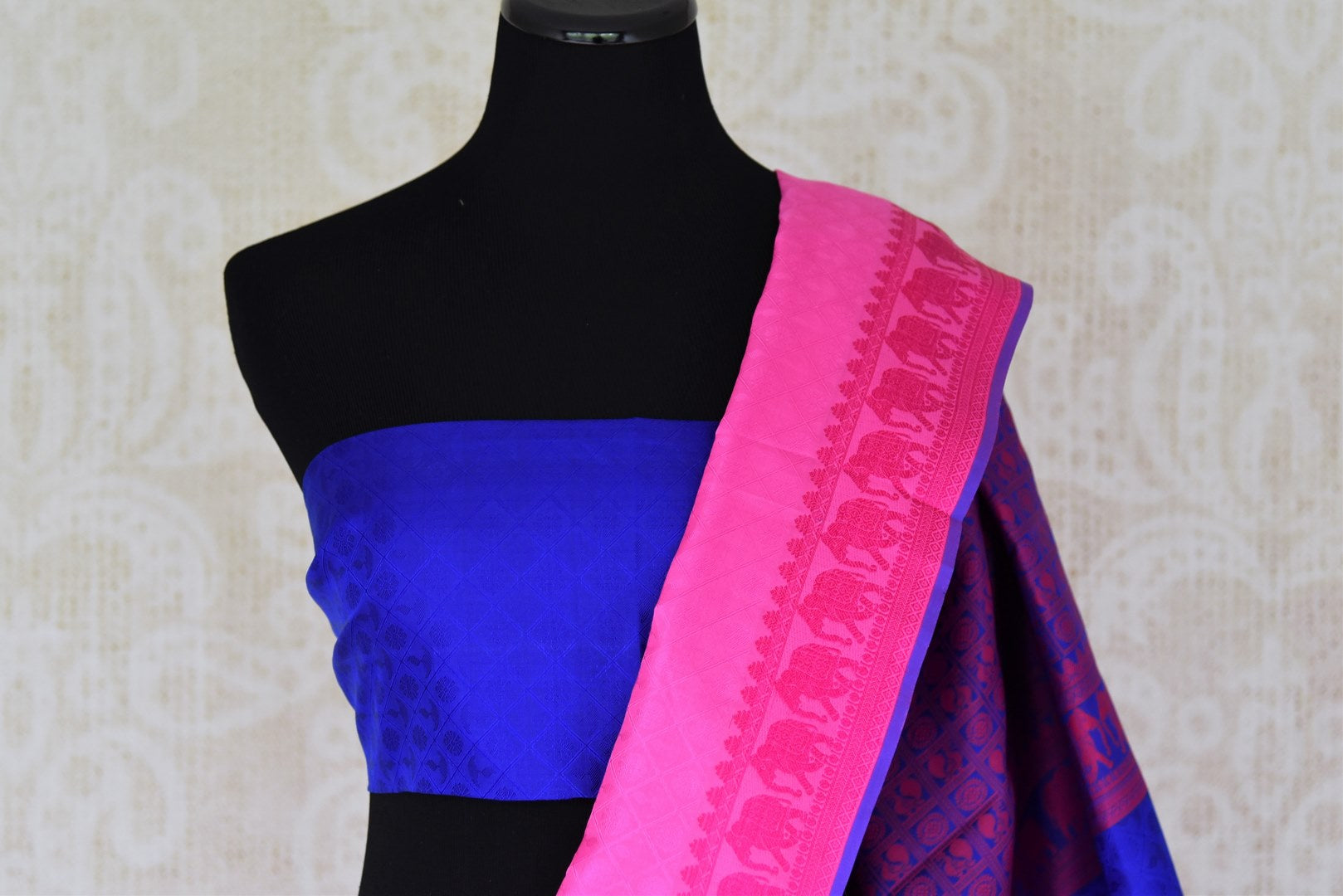 Buy elegant pink Kanjeevaram silk sari online in USA with blue pallu. Get your traditional style right with a range of beautiful Indian designer sarees from Pure Elegance clothing store in USA. Choose from a range of exquisite Banarasi sarees, Kanchipuram silk sarees, wedding sarees also available at our online store.-blouse pallu