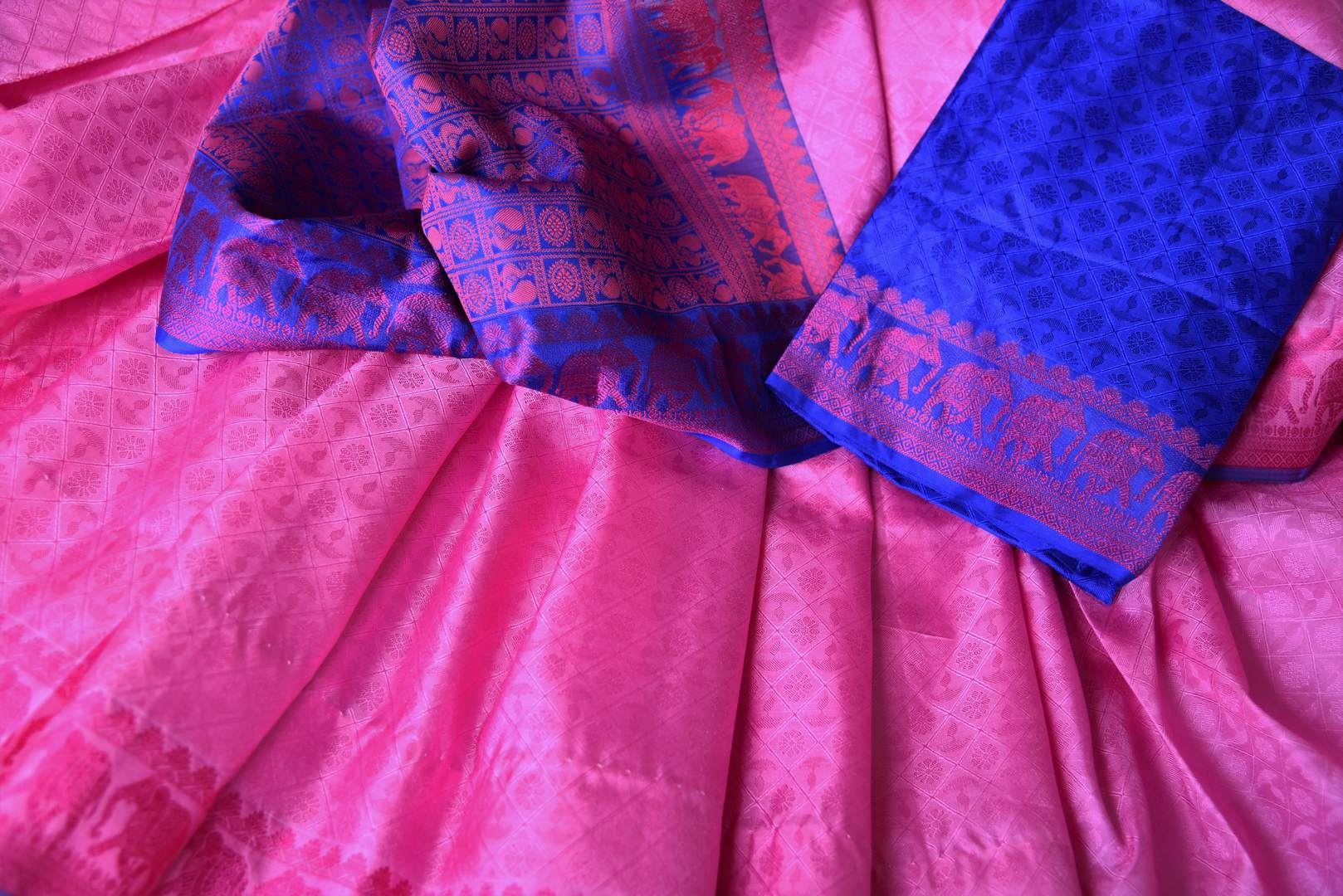 Buy elegant pink Kanjeevaram silk sari online in USA with blue pallu. Get your traditional style right with a range of beautiful Indian designer sarees from Pure Elegance clothing store in USA. Choose from a range of exquisite Banarasi sarees, Kanchipuram silk sarees, wedding sarees also available at our online store.-details