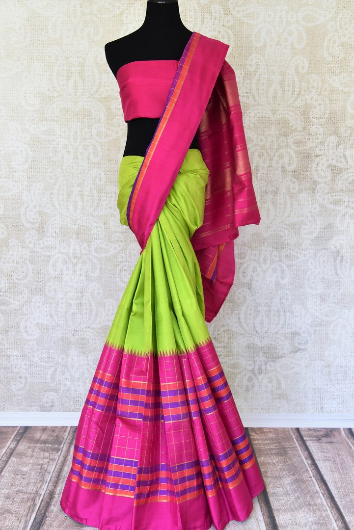 Shop green Kanchipuram silk sari with pink check border online in USA. Make your Indian saree look rich with beautiful Indian Kanjeevaram silk sarees, Indian designer sarees from Pure Elegance Indian clothing in USA or shop online.-full view