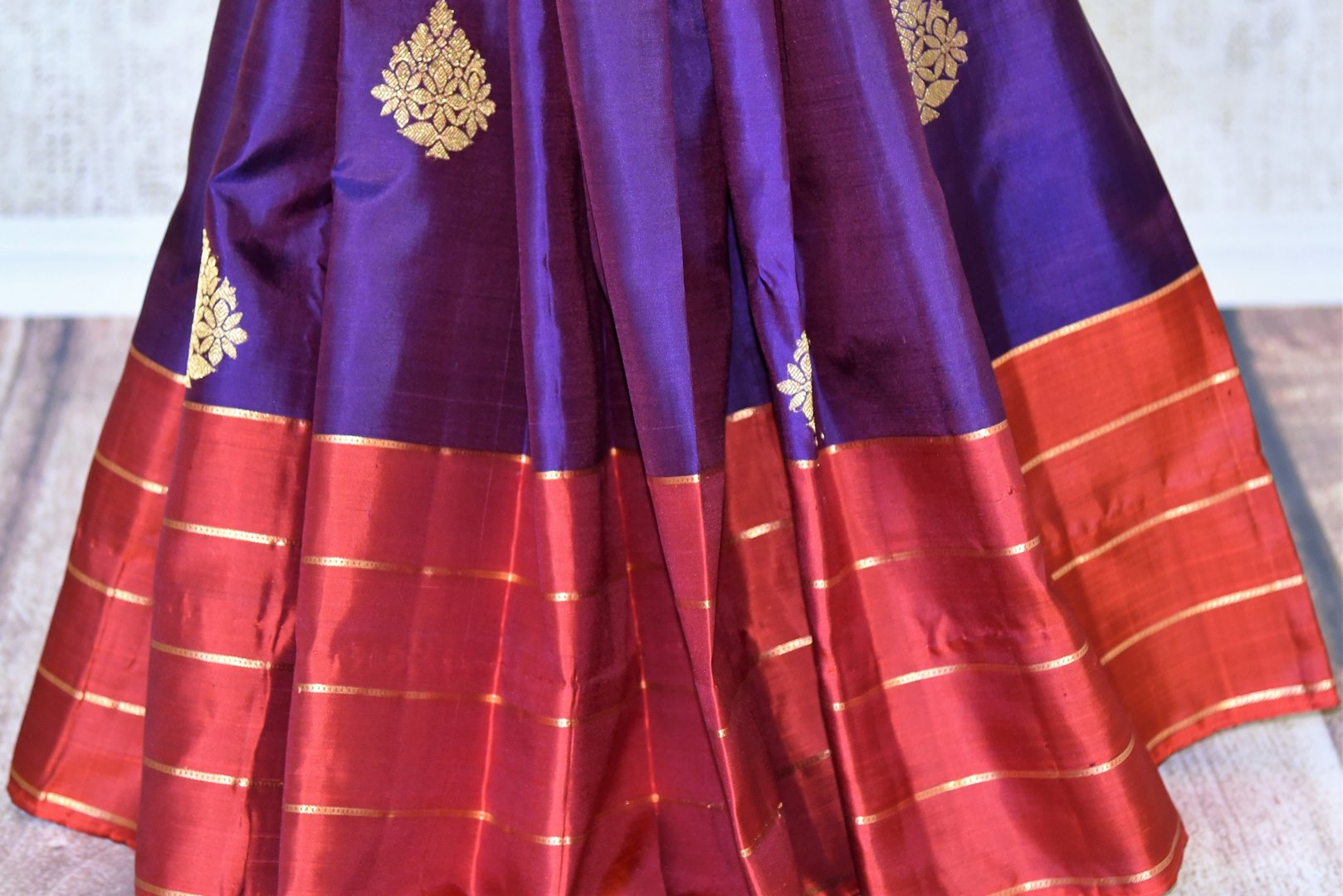 Shop purple Kanchipuram silk saree with zari buta online in USA. Adorn your style with a range of exquisite handwoven sarees from Pure Elegance Indian clothing store in USA. We have an exquisite range of Indian designer sarees, silk saris, Banarasi saris and many other varieties also available at our online store.-pleats