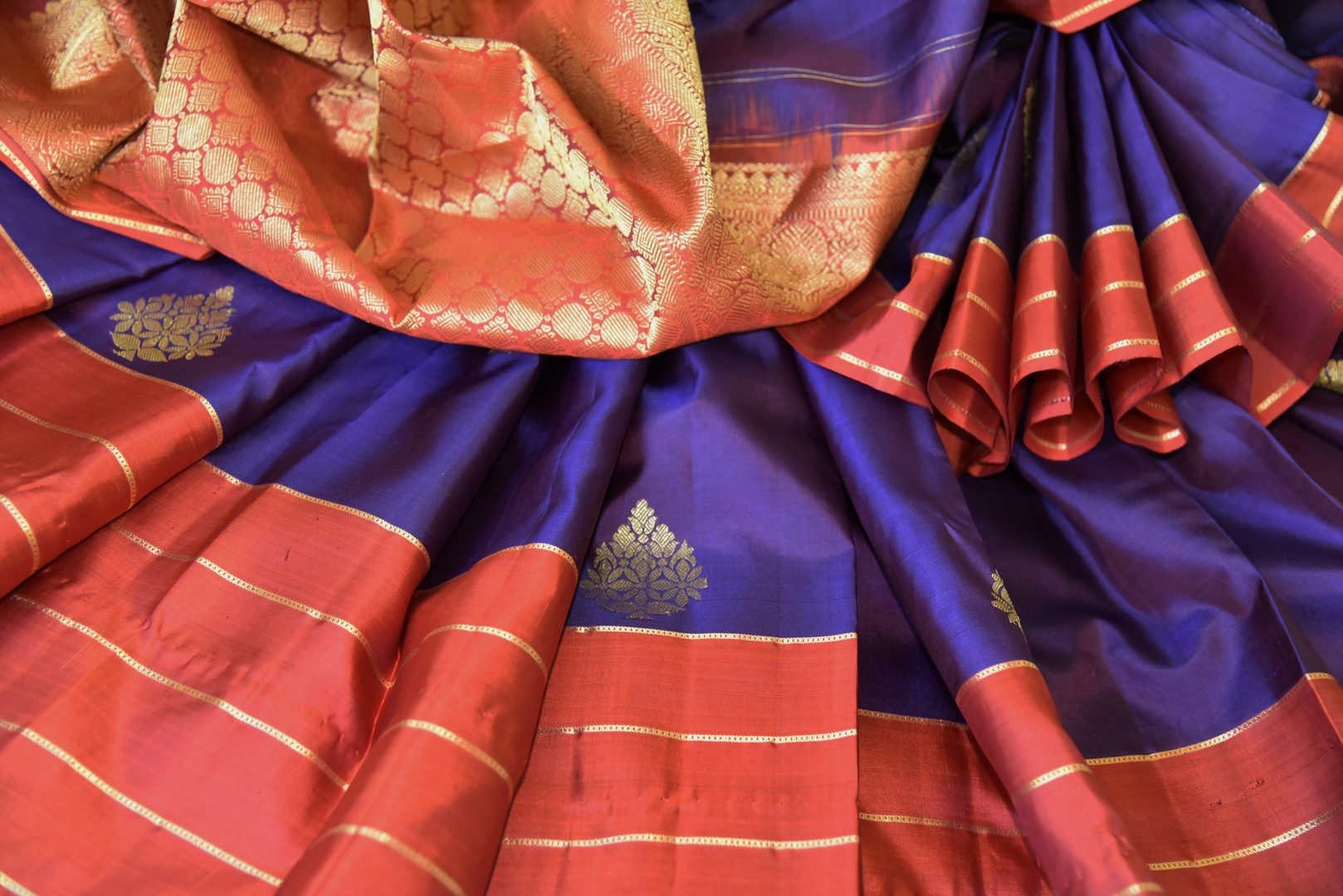 Shop purple Kanchipuram silk saree with zari buta online in USA. Adorn your style with a range of exquisite handwoven sarees from Pure Elegance Indian clothing store in USA. We have an exquisite range of Indian designer sarees, silk saris, Banarasi saris and many other varieties also available at our online store.-details