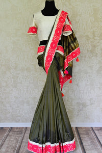 Buy green silk saree online in USA with saree blouse. Find an exquisite range of Banarasi sarees with blouses in USA at Pure Elegance Indian clothing store. Enhance your ethnic look with a variety of silk saris, Kanchipuram sarees, and Indian jewelry available at our online store.-full view