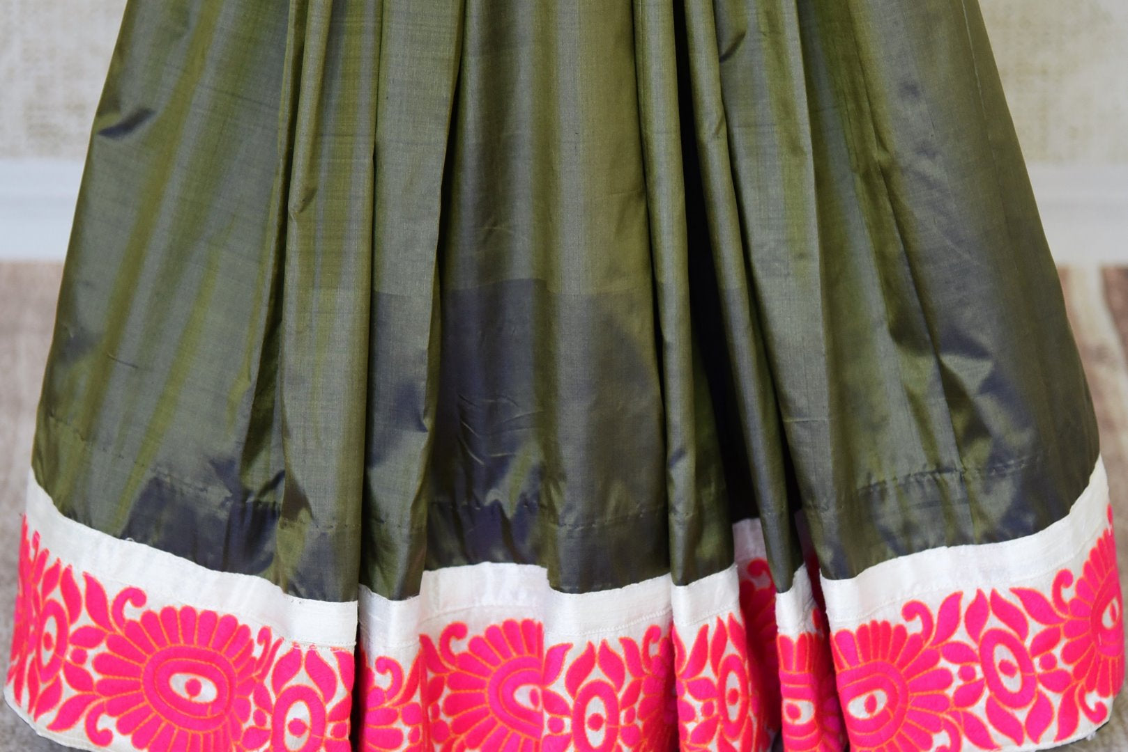 Buy green silk saree online in USA with saree blouse. Find an exquisite range of Banarasi sarees with blouses in USA at Pure Elegance Indian clothing store. Enhance your ethnic look with a variety of silk saris, Kanchipuram sarees, and Indian jewelry available at our online store.-pleats