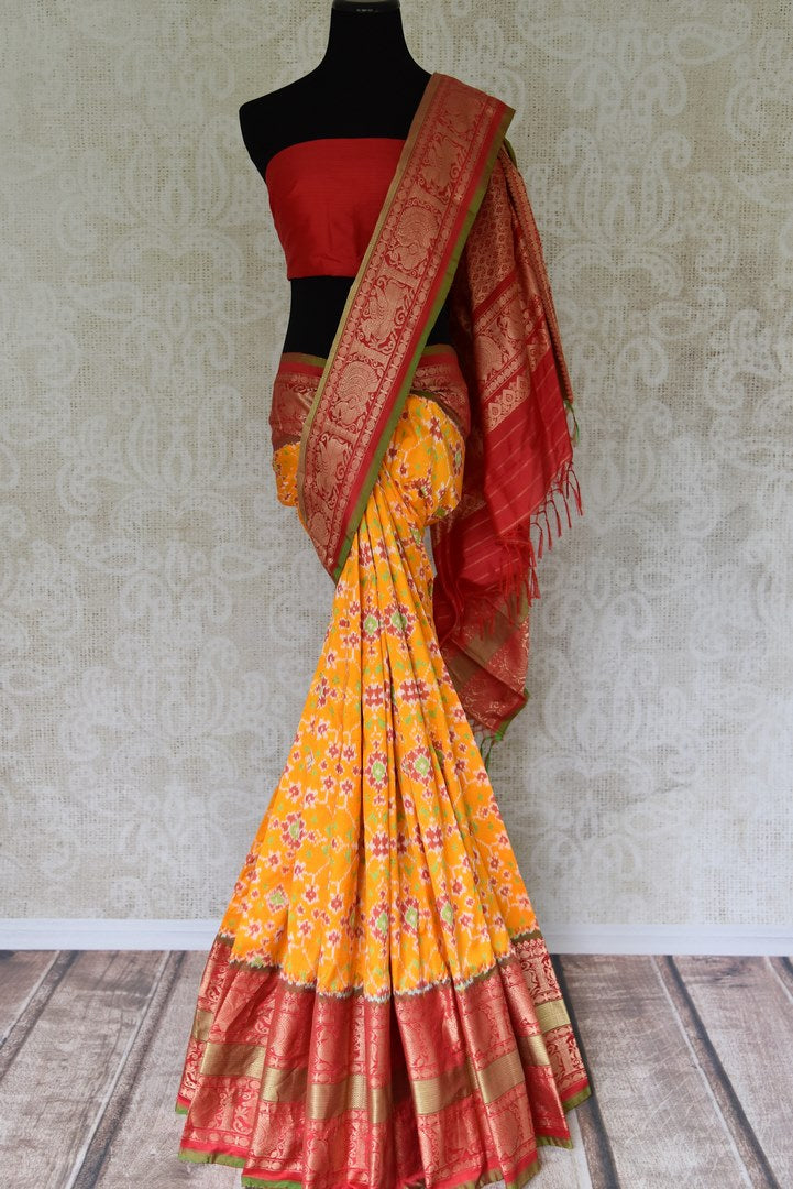 Buy yellow kanji ikkat saree online in USA with red zari border. Add the richness of Indian culture to your saree look with Kanjeevaram silk saris, Indian designer saris, bridal sarees from Pure Elegance Indian clothing in USA or shop online.-full view