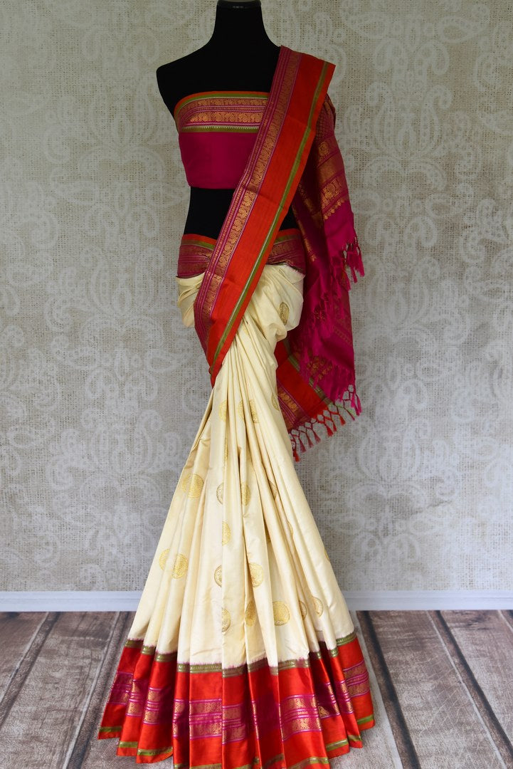 Buy off white kanji ikkat saree online in USA with red zari border and zari buta. Add the richness of Indian culture to your saree look with Kanjeevaram silk saris, Indian designer saris, bridal sarees from Pure Elegance Indian clothing in USA or shop online.-blouse pallu