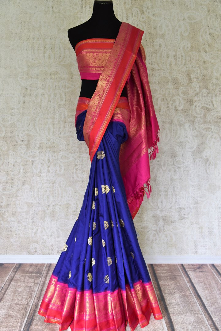 Buy stunning blue kanji ikkat saree online in USA with pink zari border and zari buta. Add the richness of Indian culture to your saree look with Kanjeevaram silk saris, Indian designer saris, bridal sarees from Pure Elegance Indian clothing in USA or shop online.-full view