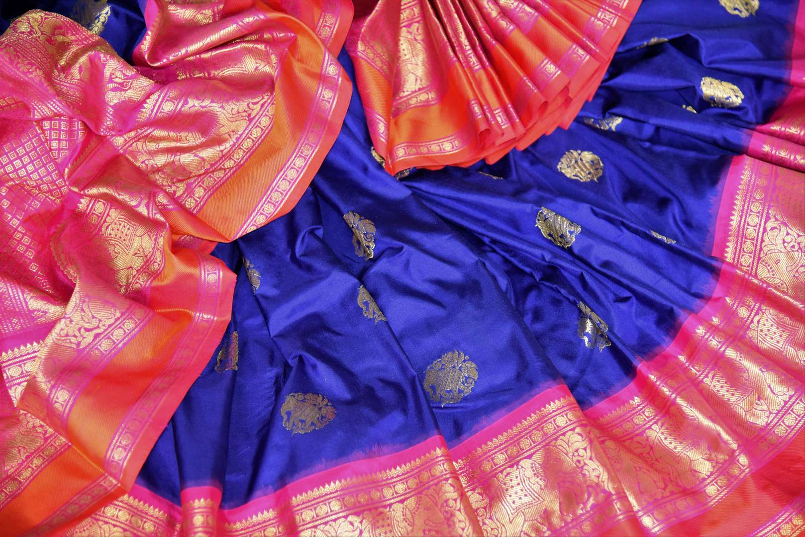 Buy stunning blue kanji ikkat saree online in USA with pink zari border and zari buta. Add the richness of Indian culture to your saree look with Kanjeevaram silk saris, Indian designer saris, bridal sarees from Pure Elegance Indian clothing in USA or shop online.-details