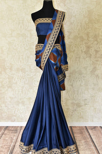 Buy designer blue crepe saree online in USA with embroidered border. Make your saree look absolutely one of a kind with Indian designer saris, bridal sarees, party sarees from Pure Elegance Indian clothing store in USA or shop online.-full view