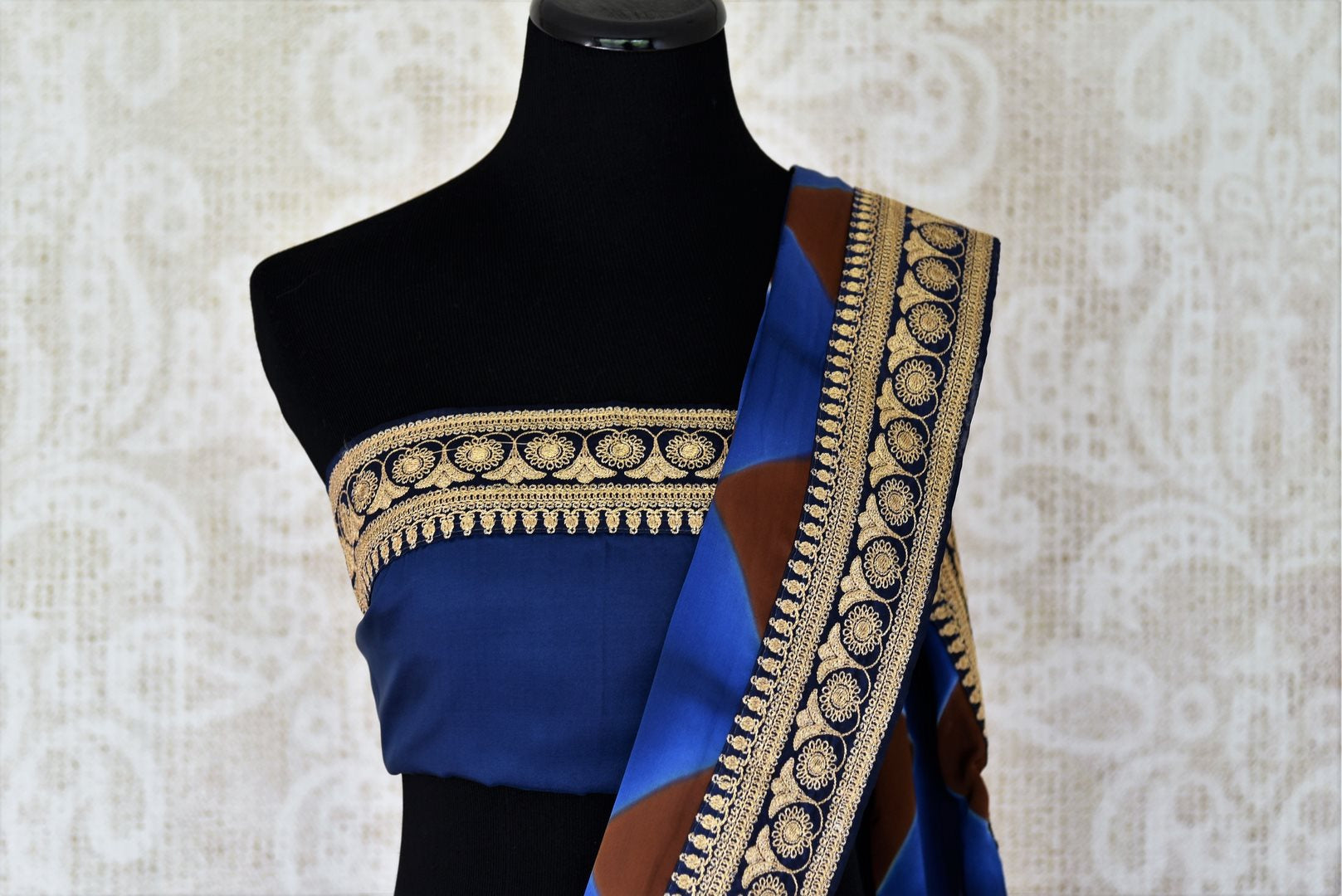 Buy designer blue crepe saree online in USA with embroidered border. Make your saree look absolutely one of a kind with Indian designer saris, bridal sarees, party sarees from Pure Elegance Indian clothing store in USA or shop online.-blouse pallu