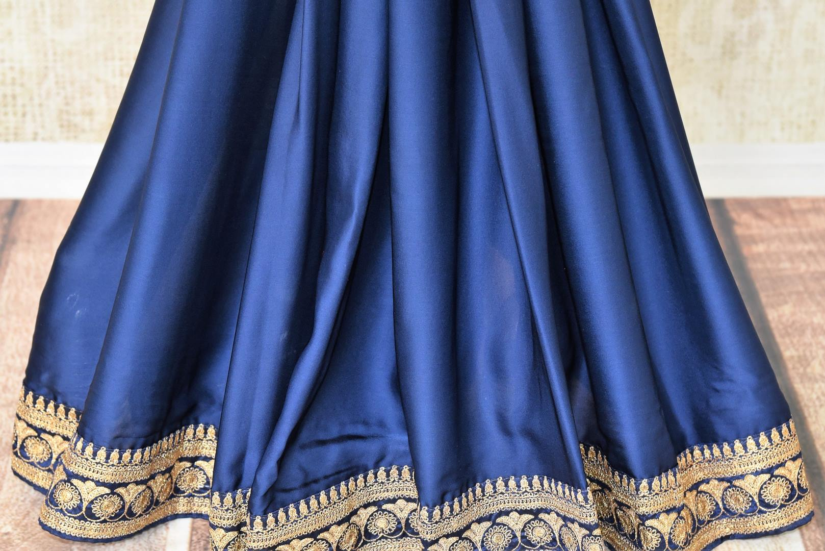 Buy designer blue crepe saree online in USA with embroidered border. Make your saree look absolutely one of a kind with Indian designer saris, bridal sarees, party sarees from Pure Elegance Indian clothing store in USA or shop online.-pleats