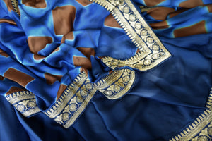 Buy designer blue crepe saree online in USA with embroidered border. Make your saree look absolutely one of a kind with Indian designer saris, bridal sarees, party sarees from Pure Elegance Indian clothing store in USA or shop online.-details