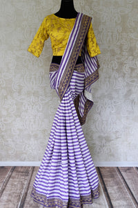 Buy purple and white stripes embroidered silk saree with blouse online in USA. Shop exclusive Indian designer saris, concept sarees, saree sets in USA at Pure Elegance clothing store. Explore a range of traditional Indian women clothing also available at our online store. Shop now.-full view