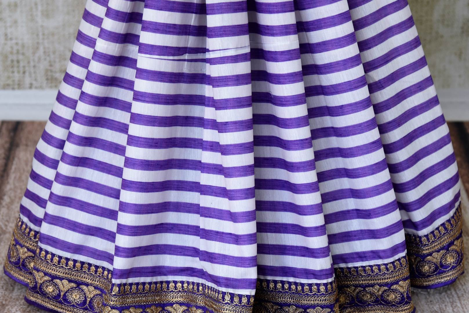 Buy purple and white stripes embroidered silk saree with blouse online in USA. Shop exclusive Indian designer saris, concept sarees, saree sets in USA at Pure Elegance clothing store. Explore a range of traditional Indian women clothing also available at our online store. Shop now.-pleats