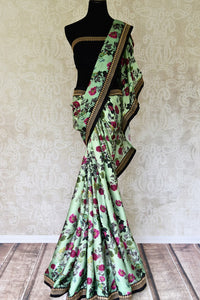 Buy pastel green floral print crepe saree online in USA with embroidered border. Add exquisite Indian designer saris, bridal sarees, party sarees to your ethnic wardrobe from Pure Elegance Indian clothing store in USA or shop online. -full view