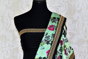 Buy pastel green floral print crepe saree online in USA with embroidered border. Add exquisite Indian designer saris, bridal sarees, party sarees to your ethnic wardrobe from Pure Elegance Indian clothing store in USA or shop online. -blouse pallu