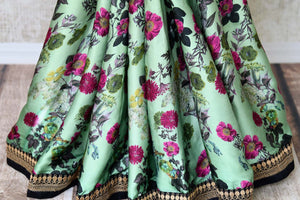 Buy pastel green floral print crepe saree online in USA with embroidered border. Add exquisite Indian designer saris, bridal sarees, party sarees to your ethnic wardrobe from Pure Elegance Indian clothing store in USA or shop online. -pleats