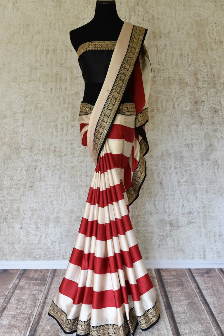 Buy designer off white and red striped crepe saree online in USA with embroidered border. Add exquisite Indian designer saris, bridal sarees, party sarees to your ethnic wardrobe from Pure Elegance Indian clothing store in USA or shop online. -full view