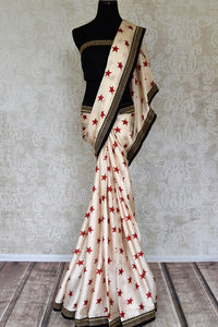 Shop off-white star print crepe saree with embroidered border online in USA from Pure Elegance. Let your ethnic style be one of a kind with an exquisite variety of Indian designer sarees, pure silk sarees, Bollywood sarees from our exclusive fashion store in USA.-full view