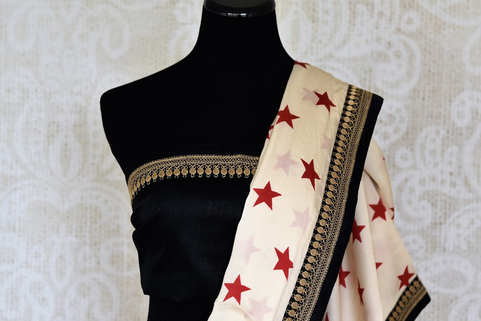 Shop off-white star print crepe saree with embroidered border online in USA from Pure Elegance. Let your ethnic style be one of a kind with an exquisite variety of Indian designer sarees, pure silk sarees, Bollywood sarees from our exclusive fashion store in USA.-blouse pallu