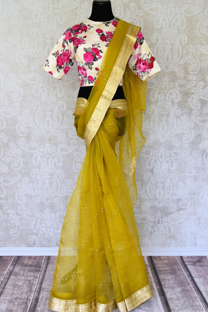 Buy mehendi color organza silk saree with zari border online in USA. It comes with a beautiful floral print designer saree blouse. Take your Indian style a notch up with a range of beautiful Indian clothing from Pure Elegance. We have a range of traditional Indian sarees, designer sarees in USA online and our fashion store.-full view