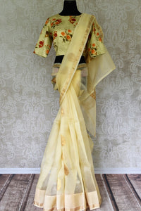 Buy light lemon organza silk saree with zari buta online in USA. It comes with a beautiful floral print satin silk saree blouse. Take your Indian style a notch up with a range of beautiful Indian clothing from Pure Elegance fashion store. We have a range of traditional Indian sarees, designer sarees in USA online.-full view