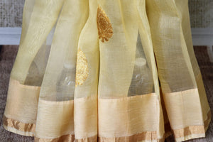 Buy light lemon organza silk saree with zari buta online in USA. It comes with a beautiful floral print satin silk saree blouse. Take your Indian style a notch up with a range of beautiful Indian clothing from Pure Elegance fashion store. We have a range of traditional Indian sarees, designer sarees in USA online.-pleats