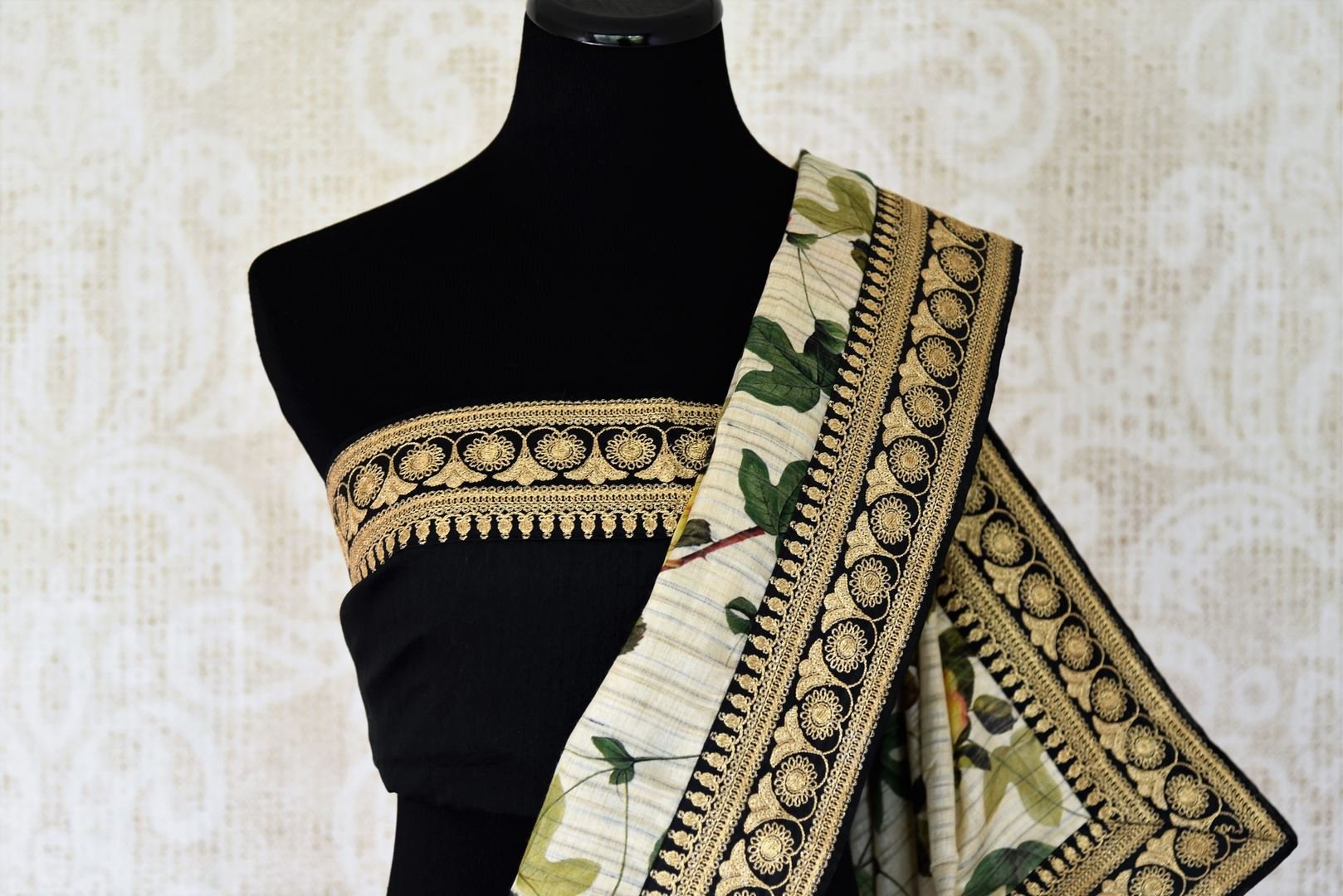 Buy off-white floral print muga tussar saree online in USA with embroidered border. Take your Indian style a notch up with a range of beautiful Indian clothing from Pure Elegance fashion store. We have a range of traditional Indian saris, designer sarees, handloom sarees in USA online and in our store. Shop now.-blouse pallu