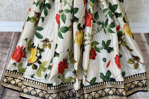 Buy off-white floral print muga tussar saree online in USA with embroidered border. Take your Indian style a notch up with a range of beautiful Indian clothing from Pure Elegance fashion store. We have a range of traditional Indian saris, designer sarees, handloom sarees in USA online and in our store. Shop now.-pleats