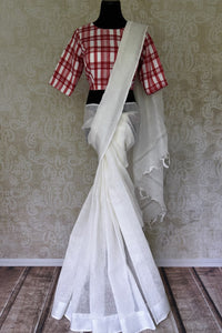 Buy handwoven white linen saree with red check sari blouse online in USA. Shop exclusive Indian designer saris, concept sarees, handloom sarees in USA at Pure Elegance clothing store. Explore a range of traditional Indian women clothing also available at our online store. Shop now.-full view