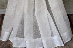 Buy handwoven white linen saree with red check sari blouse online in USA. Shop exclusive Indian designer saris, concept sarees, handloom sarees in USA at Pure Elegance clothing store. Explore a range of traditional Indian women clothing also available at our online store. Shop now.-pleats
