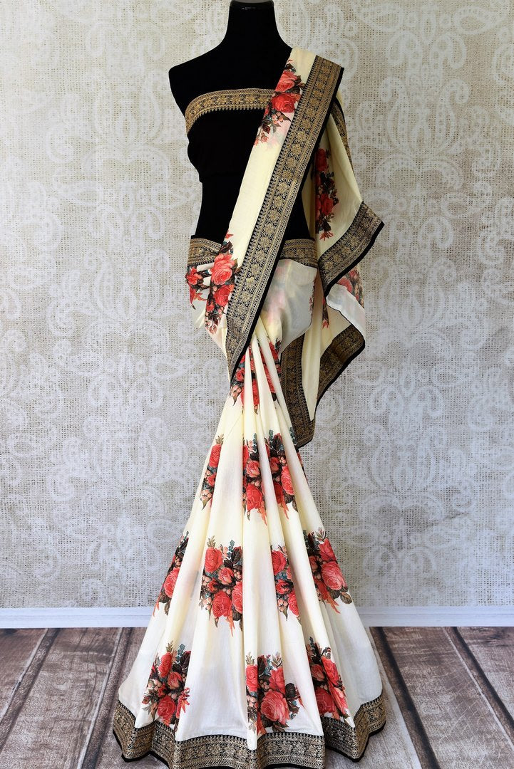 Buy off-white printed muga tussar sari online in USA with black embroidered border. Take your Indian style a notch up with a range of beautiful Indian clothing from Pure Elegance fashion store. We have a range of traditional Indian sarees, designer sarees, handloom sarees in USA online and in our store. Shop now.-full view