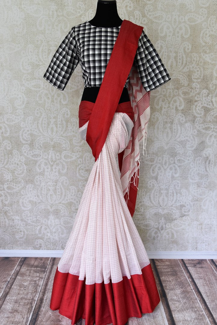 Buy off white check linen saree with black check sari blouse online in USA. Shop exclusive Indian designer saris, concept sarees, handloom saris in USA at Pure Elegance clothing store. Explore a range of traditional Indian women clothing also available at our online store. Shop now.-full view