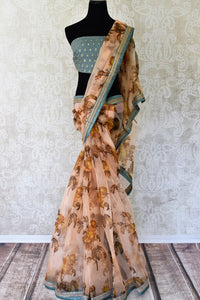 Buy peach floral print organza saree online in USA with embroidered border. Take your Indian style a notch up with a range of beautiful Indian clothing from Pure Elegance fashion store. We have a range of traditional Indian sarees, designer sarees, handloom sarees in USA online and in our store. Shop now.-full view