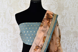 Buy peach floral print organza saree online in USA with embroidered border. Take your Indian style a notch up with a range of beautiful Indian clothing from Pure Elegance fashion store. We have a range of traditional Indian sarees, designer sarees, handloom sarees in USA online and in our store. Shop now.-blouse pallu