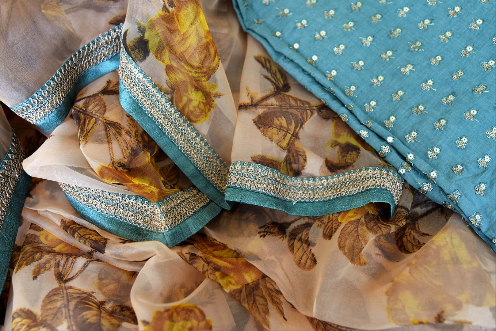 Buy peach floral print organza saree online in USA with embroidered border. Take your Indian style a notch up with a range of beautiful Indian clothing from Pure Elegance fashion store. We have a range of traditional Indian sarees, designer sarees, handloom sarees in USA online and in our store. Shop now.-details