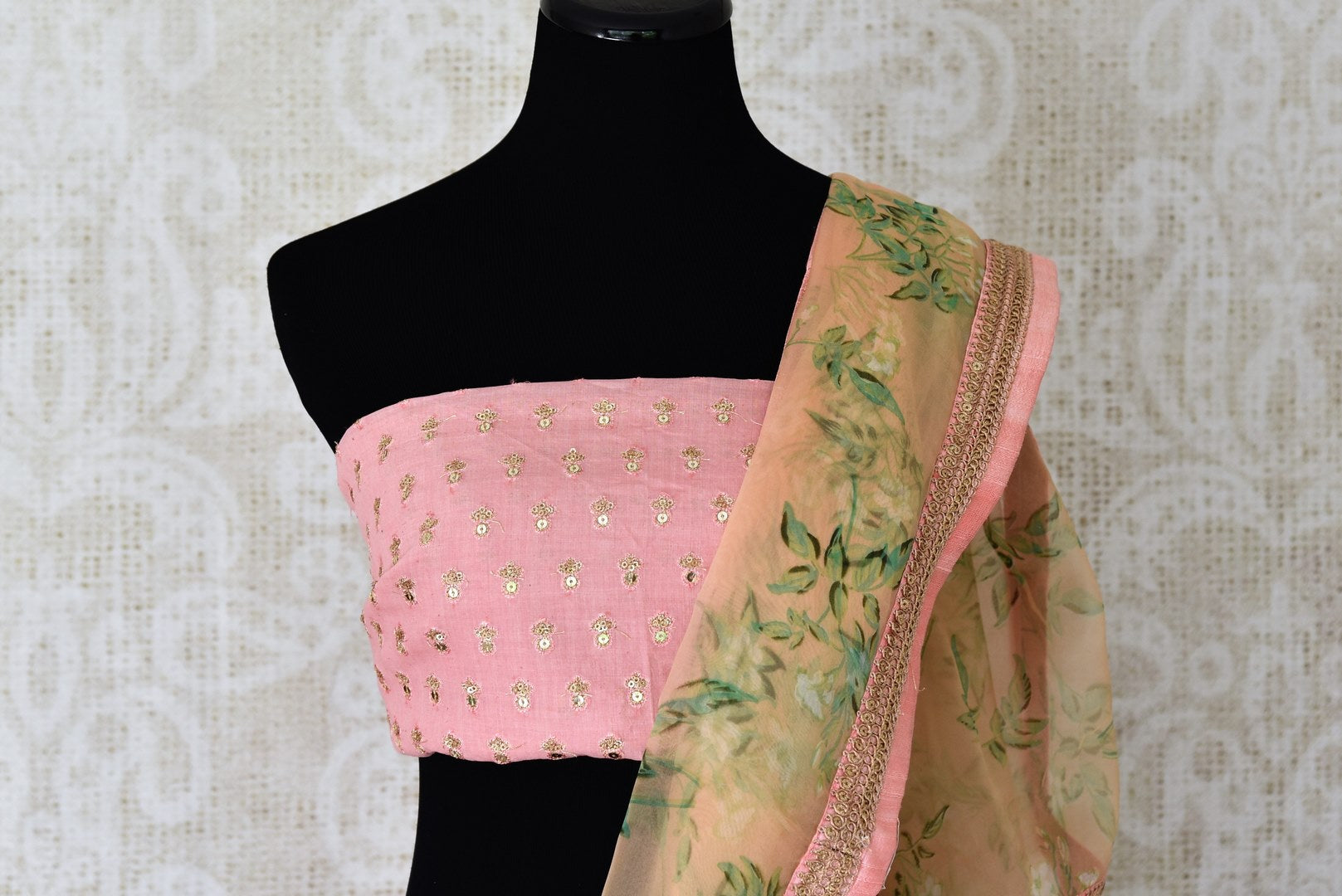 Buy peach floral organza saree online in USA with pink embroidered border. Take your Indian style a notch up with a range of beautiful Indian clothing from Pure Elegance fashion store. We have a range of traditional Indian sarees, designer sarees, handloom sarees in USA online and in our store. Shop now.-blouse pallu
